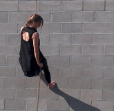Rappelling Dancer On Side Of Building Royalty Free Stock Photos