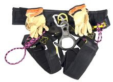Rappelling Harness. Black rappelling harness with brown leather gloves Royalty Free Stock Photography
