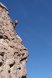 Rappelling a Stone Cliff Royalty Free Stock Photography