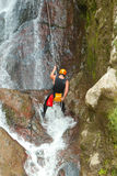 Rappelling Tall Canyon Waterfall Stock Image