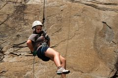 Rappelling teenager Immagine Stock