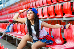 Rapper attitude rap singer hip Hop Dancer. Performing. Stylish woman and little boy sitting in the stands of stadium Stock Photography