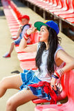 Rapper attitude rap singer hip Hop Dancer. Performing. Stylish woman and little boy sitting in the stands of stadium Stock Image
