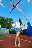 Rapper attitude rap singer hip Hop Dancer. Performing. Stylish woman posing at basketball court Stock Photos