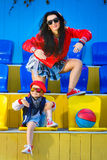Rapper attitude rap singer hip Hop Dancer. Performing. Stylish women and little boy posing at basketball court Stock Photography