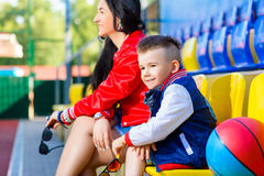 Rapper attitude rap singer hip Hop Dancer. Performing. Stylish women and little boy posing at basketball court Royalty Free Stock Image