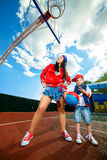 Rapper attitude rap singer hip Hop Dancer. Performing. Stylish women and little boy posing at basketball court Stock Photo