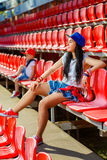 Rapper attitude rap singer hip Hop Dancer. Performing. Stylish women and little boy sitting in the stands of stadium Royalty Free Stock Images