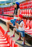 Rapper attitude rap singer hip Hop Dancer. Performing. Stylish women and little boy sitting in the stands of stadium Stock Images
