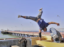 Rapper breakdancing on a boat Royalty Free Stock Photo