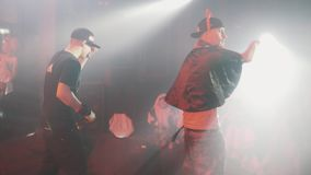 Rapper in devil horns and snapback air humping on scene on halloween party. Rapper in plastic devil horns and snapback air humping on scene on halloween party stock video