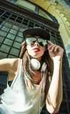 Rapper girl with headphones in a european city Stock Image