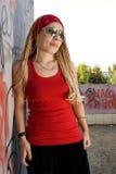 Rapper Girl Posing At Sprayed Wall Royalty Free Stock Photography
