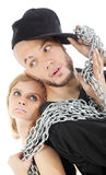 Rapper and graceful girl hold metal chain Stock Image