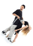 Rapper holds graceful girl by chains Stock Images