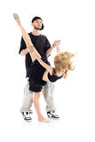 Rapper holds hands of gymnast girl, which stands on one leg stock image