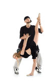Rapper holds leg of gymnast girl with ball Royalty Free Stock Photography