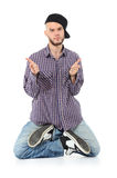 Rapper kneels with splayed feet Stock Photos