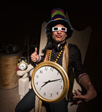 Rapper with Large Clock. Funny white rapper with multi colored hat and large clock Royalty Free Stock Images