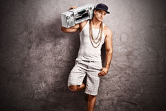 Rapper listening to music from a ghetto blaster Royalty Free Stock Photography