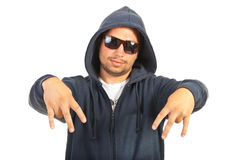 Rapper man gesturing. Hooded rapper man gesture with his fingers isolated on white background Royalty Free Stock Image