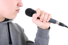 Rapper with microphone. Young rapper with dynamic microphone Royalty Free Stock Photography
