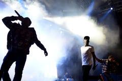 Rapper O MAIS CEDO POSSÍVEL rochoso de Harlem e membro do hip-hop da coletividade da multidão O MAIS CEDO POSSÍVEL no concerto no foto de stock