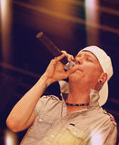 Rapper. Singing on stage over a colorful background Royalty Free Stock Photography