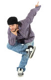 Rapper stands on one leg, props chin by hand. Smiling rapper in jeans and plaid shirt stands on one leg, props chin by his hand, points up by left hand isolated Stock Photography