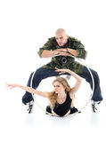 Rapper stands over girl and gymnast girl lies Stock Images