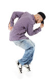 Rapper stands on tiptoe in profile Royalty Free Stock Image