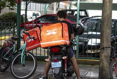 Rappi driver working at food delivery service royalty free stock images