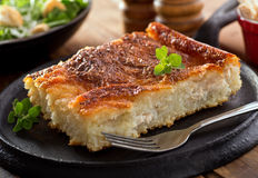 Rappie Pie. A serving of rustic homemade rappie pie made with grated potatoes and chicken Stock Image