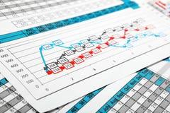 Rapporten in Veelkleurige Grafiek en Cijfers Royalty-vrije Stock Foto's