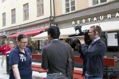 Rapportering met de inwoners van Stockholm Stock Afbeelding