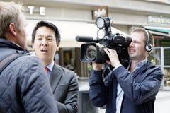 Rapportering met de inwoners van Stockholm Stock Foto's