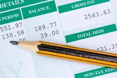 Rapportez avec le salaire mensuel Photos stock
