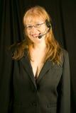 Rappresentante femminile amichevole di servizio di assistenza al cliente Fotografie Stock Libere da Diritti