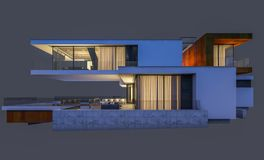rappresentazione 3d della casa moderna alla notte isolata su gray Immagine Stock