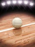 rappresentazione 3d di una pallavolo su una corte con illuminazione dello stadio Fotografia Stock