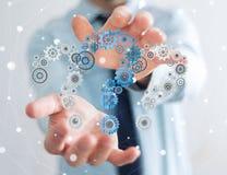 Rappresentazione dell'ingranaggio 3D dei punti interrogativi della tenuta dell'uomo d'affari Immagini Stock