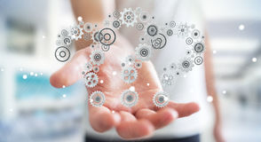 Rappresentazione dell'ingranaggio 3D dei punti interrogativi della tenuta dell'uomo d'affari Immagine Stock