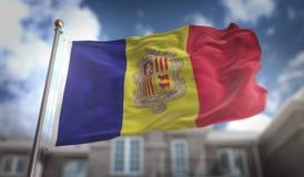 Rappresentazione della bandiera 3D dell'Andorra sul fondo della costruzione del cielo blu Immagine Stock