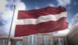 Rappresentazione della bandiera 3D della Lettonia sul fondo della costruzione del cielo blu Fotografia Stock Libera da Diritti
