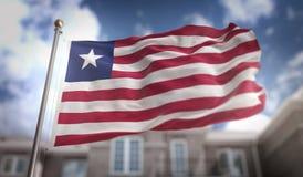 Rappresentazione della bandiera 3D della Liberia sul fondo della costruzione del cielo blu Immagine Stock Libera da Diritti