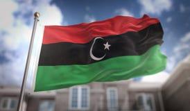 Rappresentazione della bandiera 3D della Libia sul fondo della costruzione del cielo blu Fotografia Stock