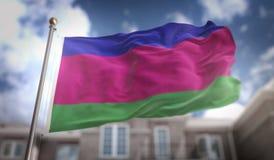 Rappresentazione della bandiera 3D della Repubblica del ` s della gente di Kuban sul cielo blu che costruisce B Immagini Stock Libere da Diritti