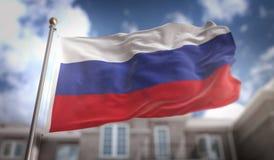 Rappresentazione della bandiera 3D della Russia sul fondo della costruzione del cielo blu Fotografia Stock Libera da Diritti