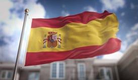 Rappresentazione della bandiera 3D della Spagna sul fondo della costruzione del cielo blu Fotografie Stock