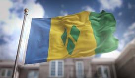 Rappresentazione della bandiera 3D di Saint Vincent e Grenadine sul cielo blu B Immagini Stock Libere da Diritti